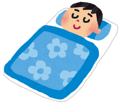 布団で熟睡している男の子